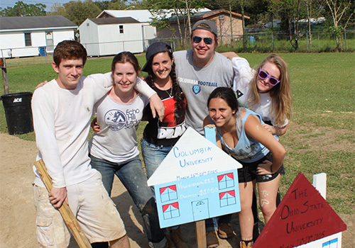 Students from the Columbia University students pose at their Habitat for Humanity work site in Lafayette, Louisiana. the student spent their Spring Break volunteering their time to help build homes for those in need.