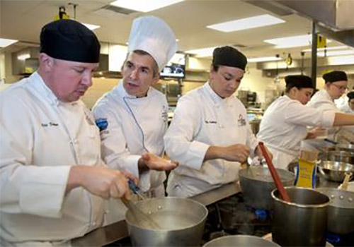 Instructor Peter Tobin (second from left) helps prepare Spokane Community College students for careers in the culinary arts.
