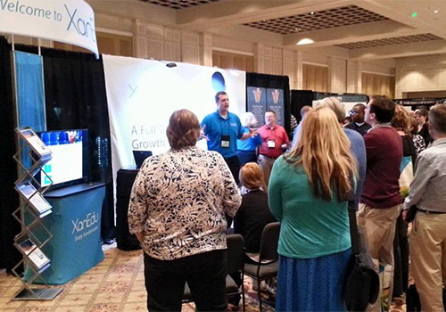 Representatives from XanEdu presents to  at Barnes & Noble College's Annual Meeting in Orlando, Florida.