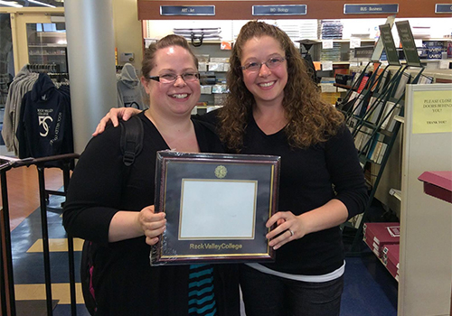 Rock Valley College senior Amanda Martinez (with friend Karen Kersey) was the winner of the RVC Diploma Frame from its Grad Fair.