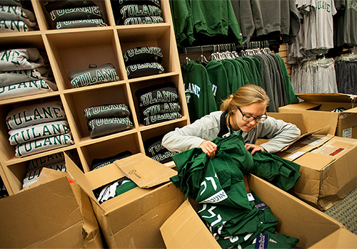 Leah Weaver unpacks boxes of new merchandise in the Tulane University Bookstore, located in the Lavin-Bernick Center on the uptown campus, on Thursday afternoon (June 11). Weaver is a sophomore in the Tulane School of Public Health and Tropical Medicine.