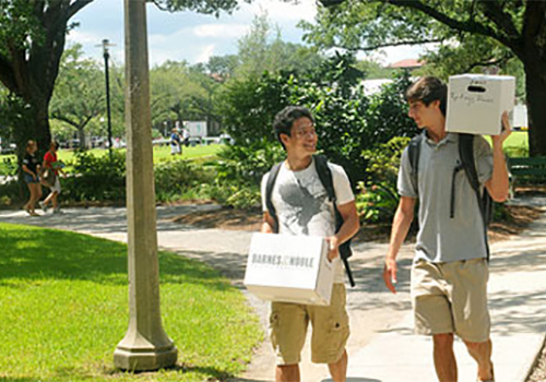 Tulane University students pick up their textbook orders from the campus bookstore as they prepare for a new school year.
