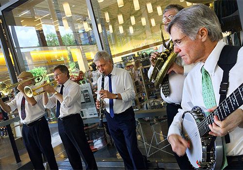 Outside the Tulane Bookstore in the Lavin-Bernick Center for University Life, the John Parker New Orleans Jazz Band performs traditional jazz for visitors to campus. The New Student Orientation program, which introduces undergraduate students and their families to campus resources and opportunities both in and outside the classroom, ran through June 29.
