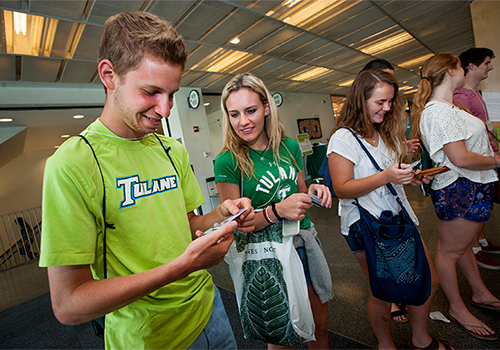 Taking part in the New Student Orientation, first-year students, from left, Griffin Kulick, Alex Bonomo and Sophie Buchanan survey their newly minted SplashCards on Tuesday (June 23) in the lobby of the Lavin-Bernick Center on the Tulane University uptown campus. The SplashCard is a picture ID that works as an all-in-one card for meal plans, library services, computer labs and more.