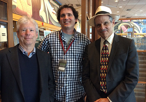 Professor Richard Thaler, Store Manager Kevin Bendle and PBS's Paul Solman, pose in the Gleacher Center bookstore.
