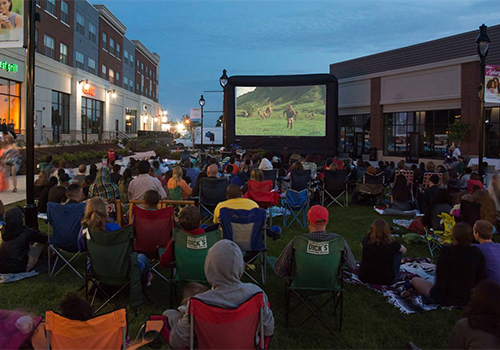 College Town hosts Movies Under The Stars during July and August. The free event is open to the public and helps draws business to the College Town eating establishments and stores.