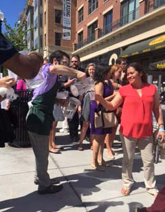 Barnes & Noble at The Catholic University of America bookstore manager Jonathan Howard pours water for people standing in line waiting to get through security to attend Pope Francis' mass at CUA.