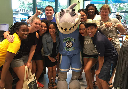 Hawaii Pacific University students pose with their mascot, Sharky the Sea Warrior, on VIP Night.