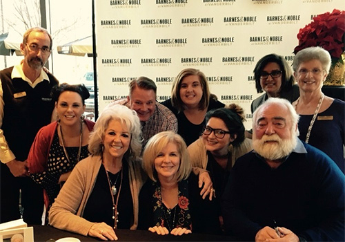 Celebrity chef Paula Deen poses with the staff of the Barnes & Noble at Vanderbilt University Bookstore in Nashville, Tennessee.