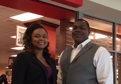Desiree Hightower poses with General Manager Felix Robinson at the Barnes & Noble at the University of Houston bookstore.
