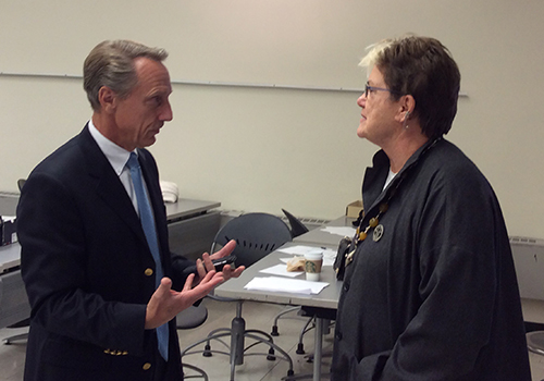 Barnes & Noble College's Vice President of Design & Construction, Greg Candee, chats with Susan Forbes, FIT's Associate Professor of Interior Design, before students presented their design projects.
