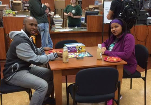 University of North Carolina Charlotte enjoy some pizza and games during the bookstore's DeStress Fest.