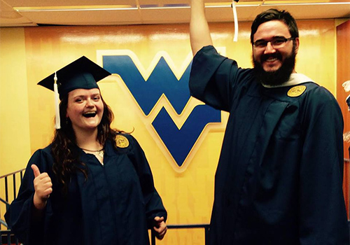 Students try on their caps and gowns at the West Virginia University bookstore located in Morgantown, West Virginia.