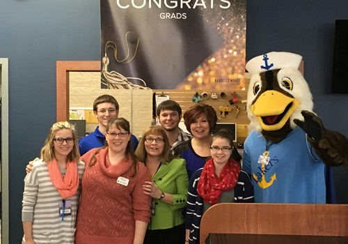 Lake Superior University students and faculty pose with school mascot, Seamore the Sea Duck. Lake Superior University located in Sault Sainte Marie, Michigan.