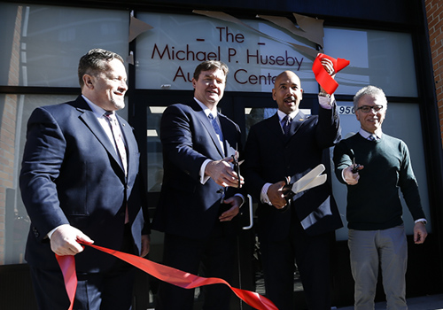 Michael P. Huseby, executive chairman of Barnes & Noble Education, cuts the ribbon at QSAC's new Michael P. Huseby Autism Center in the Bronx. He is joined by QSAC and Bronx city officials, including QSAC CEO Gary A. Maffei, Bronx Borough President Ruben Diaz Jr, and New York City Council Member Jimmy Vacca. Photo credit: Jeff Zelevansky