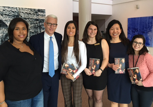 Tufts University Bookstore Manager Boon Teo (second from right) poses with her staff and Anderson Cooper at his recent book signing.