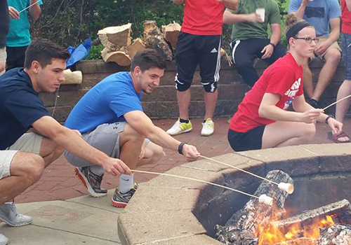 Students at Robert Morris University in Moon Township, PA, make s'mores at their bookstore's De-Stress Event.