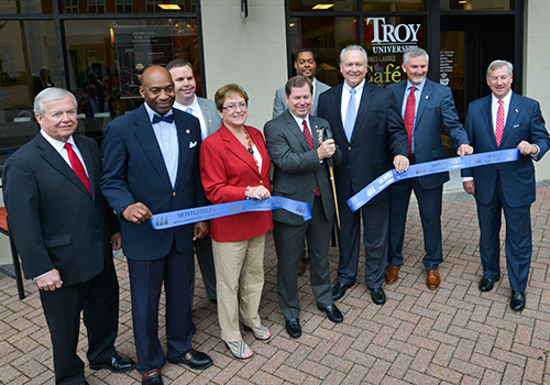 The ribbon-cutting ceremony of Troy University's grand opening of the Barnes & Noble Trojan Cafe. From left to right are: Randall George, President of the Montgomery Area Chamber of Commerce; Alabama Labor Commissioner Fitzgerald Washington; Bobby Hamous, Regional Manager, Barnes & Noble College; Karen Carter, Troy University Trustee; Dr. Lance Tatum, Vice Chancellor of Troy University Montgomery; Cavan Myers, store manager; Dr. Jim Bookout, Senior Vice Chancellor for Finance and Business Affairs at TROY; Brian Stark, Vice President of Stores for Barnes & Noble College and a TROY alumnus; and, Montgomery Mayor Todd Strange. (TROY PHOTO/ Kevin Glackmeyer)