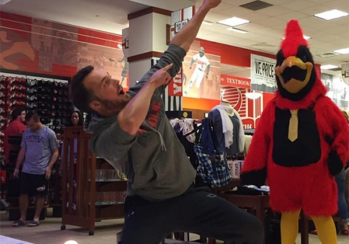 A student at Catholic University posed with Red the Cardinal at their recent VIP night. Catholic University is located in Washington, DC.