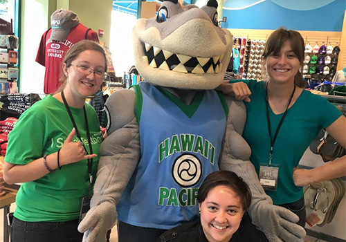 Student booksellers at Hawaii Pacific University posed with school mascot, Sharky the Sea Warrior, at their VIP event this fall. Hawaii Pacific University is located in Honolulu, Hawaii.