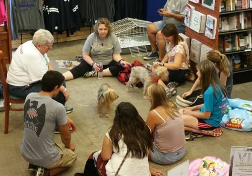 In Toledo, Ohio at the University of Toledo bookstore, students played with puppies at the VIP event this fall.