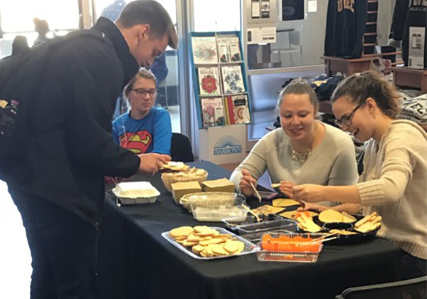 Students at the University of Wisconsin Eau Claire Bookstore decorate cookies at the recent College Con event.